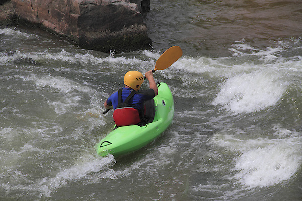 Kayaker in whitewater, Denver, Colorado, USA.