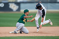 Siena Saints second baseman Yasser Santana (7) tags Dalton Wingo (35) sliding in during a game against the UCF Knights on February 17, 2019 at John Euliano Park in Orlando, Florida.  UCF defeated Siena 7-1.  (Mike Janes/Four Seam Images)