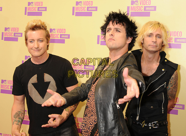 Tre Cool, Billie Joe Armstrong, Mike Dirnt of Green Day.arriving at the 2012 MTV Video Music Awards at Staples Center in Los Angeles, California, USA, .September 6th, 2012..arrivals vmas vma  half length band group black leather jacket leopard print waistcoat  funny hands arms .CAP/ROT/TM.©TM/Roth Stock/Capital Pictures