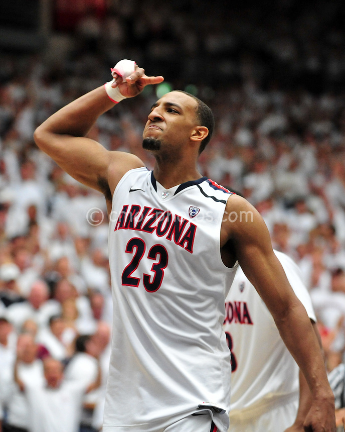 Feb 19, 2011; Tucson, AZ, USA; Arizona Wildcats forward Derrick Williams (23) salutes the student section after an 87-86 victory over the Washington Huskies at the McKale Center.