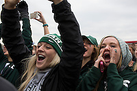 Michigan State fans react as their team accepts their national title trophy during the NCAA Cross Country Championships in Terre Haute, Ind. on Saturday, Nov. 22, 2014. (James Brosher, Special to the Denver Post)