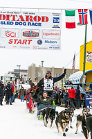 Jessie Holmes  and team leave the ceremonial start line with an Iditarider and handler at 4th Avenue and D street in downtown Anchorage, Alaska on Saturday March 7th during the 2020 Iditarod race. Photo copyright by Cathy Hart Photography.com