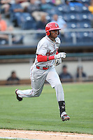 Ti'Quan Forbes (10) of the Spokane Indians runs to first base during a game against the Everett AquaSox at Everett Memorial Stadium on July 24, 2015 in Everett, Washington. Everett defeated Spokane, 8-6. (Larry Goren/Four Seam Images)