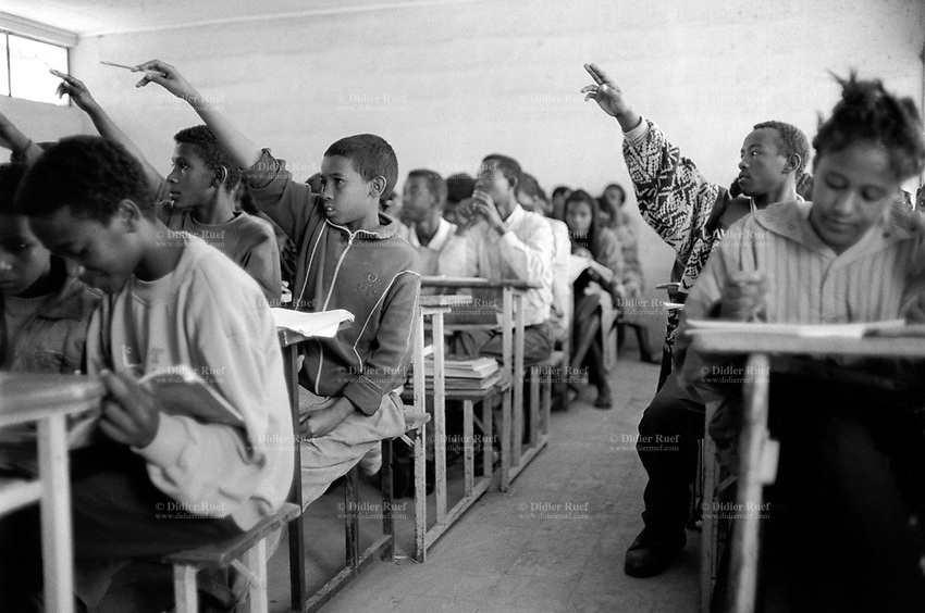 Ethiopia. Addis Ababa is the capital city and the name of a region of Ethiopia. Habib (second from right) is a member of the Circus Ethiopia. He seats in his classroom during a mathematics class at Misrak Comprehensive High School. Some students are raising their hands. Circus Ethiopia was legally established in 1991 with a view to introduce circus art in Ethiopia. © 1996  Didier Ruef