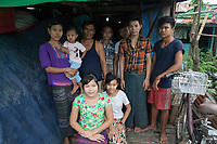 Nila* and her husband Ko Kyaw Kyaw* together with their employed workers in front of their house. They run a home-based business baking cakes and packaging dry noodles which are sold in local markets. They all live together on the second floor of the house.