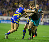 2nd February 2019, Halliwell Jones Stadium, Warrington, England; Betfred Super League rugby, Warrington Wolves versus Leeds Rhinos; Liam Sutcliffe is tackled by Toby King