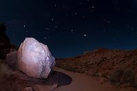 Flashlit Boulder Under Desert Stars, Arches National Park, Utah, US