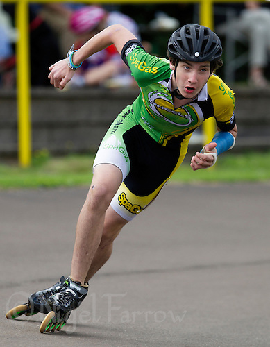 11 AUG 2013 - BIRMINGHAM, GBR - Will Dobson of Birmingham Wheels Roller Speed Club races round a bend during the Pupil and Cadet Boy's 3000m Relay at the Federation of Inline Speed Skating 2013 British Outdoor Championships at Birmingham Wheels Park in Birmingham, West Midlands, Great Britain (PHOTO COPYRIGHT © 2013 NIGEL FARROW, ALL RIGHTS RESERVED)