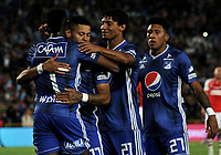 BOGOTÁ-COLOMBIA, 15-01-2020: Hanzel Zapata de Millonarios, celebra con sus compañeros de equipo el gol anotado a Independiente Santa Fe, durante partido entre Millonarios y el Independiente Santa Fe, por el Torneo ESPN 2020, jugado en el estadio Nemesio Camacho El Campin de la ciudad de Bogotá. / Hanzel Zapata of Millonarios, celebrate with his teammates a goal scoring to Independiente Santa Fe, during a match between Millonarios and Independiente Santa Fe, for the ESPN Tournament 2020, played at the Nemesio Camacho El Campin stadium in the city of Bogota. Photo: VizzorImage / Luis Ramírez / Staff.