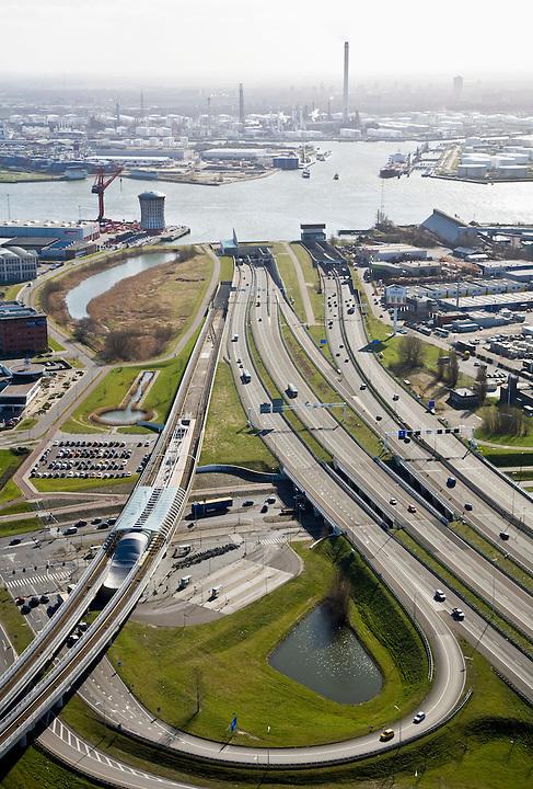 Nederland, Zuid-Holland, Schiedam, 04-03-2008; autosnelweg A4 met op- en afritten, toerit naar de Beneluxtunnel; rivier de Nieuwe Maas aan de horizon, methet hoofdkantoor van de Mammoet-van Seumeren Group (Groep) -  naast de rode kraan; links in beeld de metrolijn naar Hoogvliet (Calandlijn) met station Vijfhuizen en het het bedrijventerrein Vijhuizen (op  het terrein van de voormalige werf Wilton-Fijenoord); aan de horizon - met schoorstenen de Shell olieraffinaderij in Pernis. .luchtfoto (toeslag); aerial photo (additional fee required); .foto Siebe Swart / photo Siebe Swart