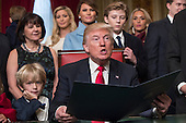 United States President Donald Trump is joined by the Congressional leadership and his family as he formally signs his cabinet nominations into law, Friday, Jan. 20, 2017, in the President's Room of the Senate on Capitol Hill in Washington. <br /> Credit: J. Scott Applewhite / Pool via CNP