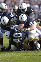 29 October 2005:  Penn State's defense gang tackles Purdue RB Jerod Void.  Scott Paxson (41), Matthew Rice (55), Anwar Phillips (1), Tim Shaw (20), Dan Connor (40), and Paul Posluszny (31).  The Penn State Nittany Lions defeated the Purdue Boilermakers 33-15 October 29, 2005 at Beaver Stadium in State College, PA..