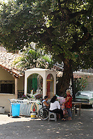 Virgin of Guadalupe shrine in the Pozo de la Nacion historic district, Acapulco, Mexico. Founded in 1850, this is the oldest residential neighborhood in Acapulco.