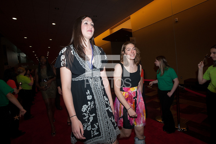 INDIANAPOLIS, IN - APRIL 1, 2011: Sarah Boothe and Toni Kokenis walk the red carpet at the Indianapolis Convention Center at Tourney Town during the NCAA Final Four in Indianapolis, IN on April 1, 2011.