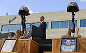Fort Hood, TX - November 10, 2009 -- U.S. President Barack Obama stands between two Soldiers Crosses and photos of the fallen as he speaks at the memorial service for the 12 soldiers and one civilian killed at Fort Hood U.S Army Post near Killeen, Texas, USA 10 November 2009. Army Major Malik Nadal Hasan reportedly shot and killed 13 people, 12 soldiers and one civilian, and wounded 30 others in a rampage 05 November at the base's Soldier Readiness Center where deploying and returning soldiers undergo medical screenings.  .Credit: Tannen Maury / Pool via CNP