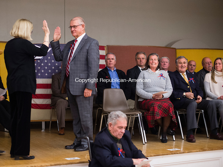 MIDDLEBURY, CT- 8 December 2015-120815EC10-   Middlebury's First Selectman, Edward St. John, is sworn in at the Shepardson Community Center in Middlebury Tuesday night by Edith Salisbury. Erin Covey Republican-American