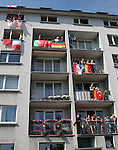 10 June 2006: An apartment building overlooking FIFA Fan Fest is adorned with various national flags. England played Paraguay at Commerzbank Arena in Frankfurt, Germany in match 3, a Group B first round game, of the 2006 FIFA World Cup.