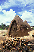 Amazon, Brazil. Charcoal making yard with sealed conical mud charcoal ovens.
