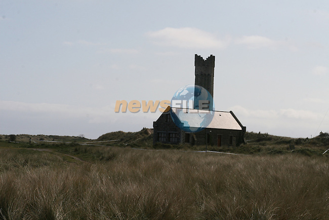 Police remain at the scene of yesterdays fatal shooting in the dunes at Mornington beach...Photo NEWSFILE/Jenny Matthews.(Photo credit should read Jenny Matthews/NEWSFILE)....This Picture has been sent you under the condtions enclosed by:.Newsfile Ltd..The Studio,.Millmount Abbey,.Drogheda,.Co Meath..Ireland..Tel: +353(0)41-9871240.Fax: +353(0)41-9871260.GSM: +353(0)86-2500958.email: pictures@newsfile.ie.www.newsfile.ie.FTP: 193.120.102.198.