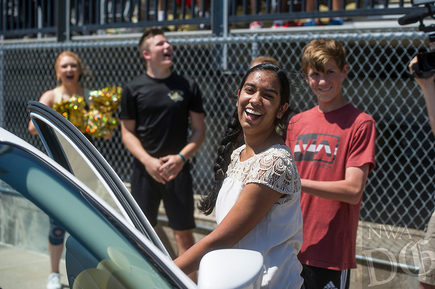 NWA Democrat-Gazette/ANTHONY REYES @NWATONYR<br /> Apoorva Krovvidi, 17, smiles Tuesday, May 16, 2017 as she realizes she won a 2016 Nissan Versa  from McLarty Daniel in their car giveaway at Tiger Stadium in Bentonville. The dealership gave a car to a student in their &quot;Attendance is the Key&quot; initiative at Bentonville, Bentonville West, Rogers and Rogers Heritage high schools. The Bentonville student had to meet attendance requirements to earn entries to the contest. The entries were pooled, then ten names were drawn with each person getting a key to try on the car.