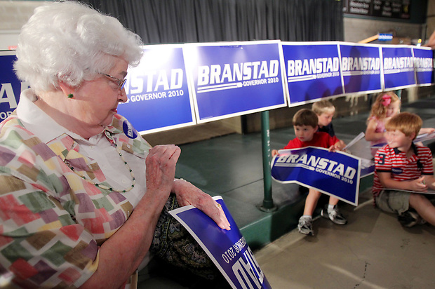 Long-time Terry Branstad supporter Margaret Roby, of Urbandale, waves to a group of young Branstad supporters while waiting for Branstad's arrival to his rally Tuesday night, June 8, 2010, at the 7 Flags Event Center in Clive.