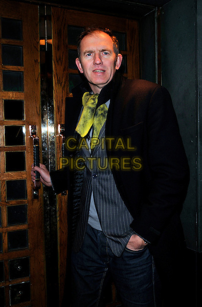 ANTON CORBIN.At The Evening Standard British Film Awards, The Ivy,.London, England, February 3rd 2008..half length hand waving green tie scarf black coat jeans.CAP/CAN.?Can Nguyen/Capital Pictures