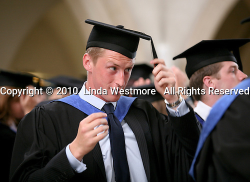 Students adjust their mortarboards, degree ceremony, University of Surrey.