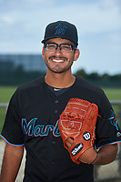 GCL Marlins Giovanni Lopez (34) poses for a photo after a Gulf Coast League game against the GCL Cardinals on August 12, 2019 at the Roger Dean Chevrolet Stadium Complex in Jupiter, Florida.  GCL Marlins defeated the GCL Cardinals 9-2.  (Mike Janes/Four Seam Images)