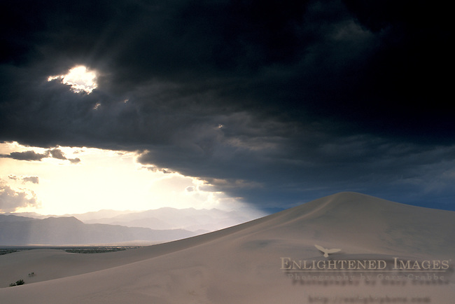 Spring storm clouds at sunset over sand dunes at sunset, Stovepipe Wells, Death Valley National Park, California