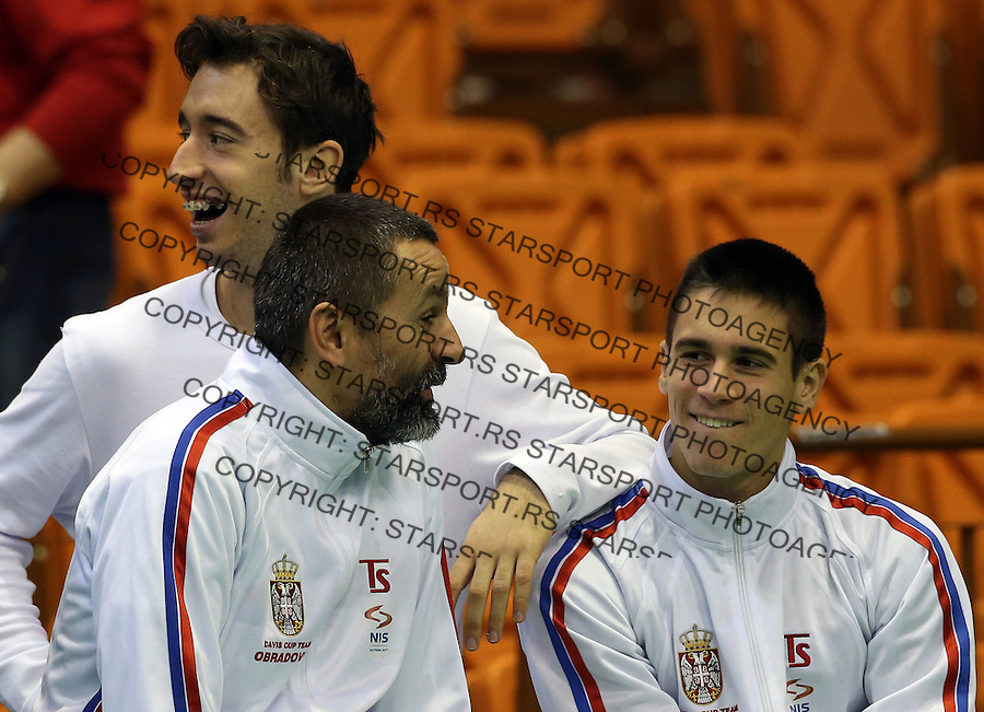 Davis Cup 2014 first round<br /> Serbia v Switzerland<br /> Team captain Bogdan Obradovic speaks with Djordje Djokovic (R) and Nikola Milojevic (C)<br /> Novi Sad, 02.02.2014.<br /> Foto: Srdjan Stevanovic/Starsportphoto.com&copy;