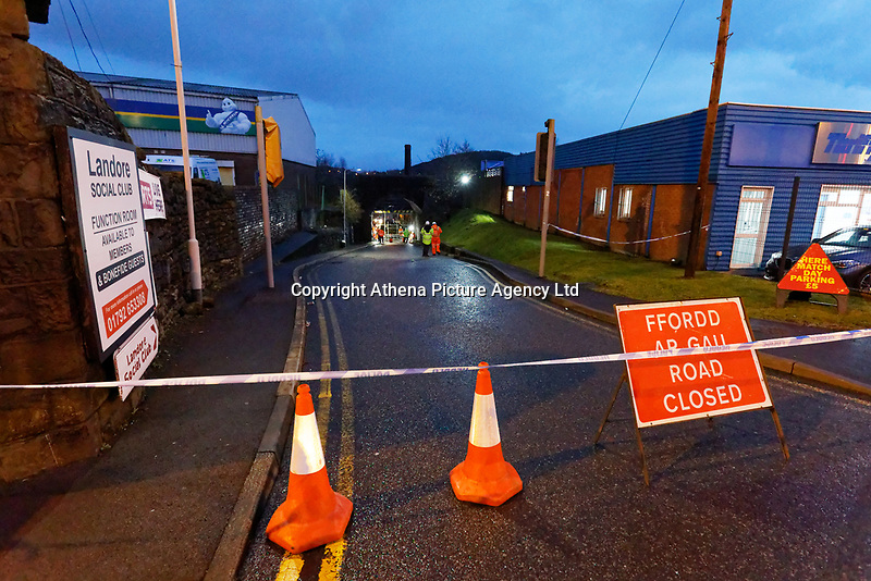 Pictured: The closed off road after the double decker bus was recovered. Thursday 12 December 2019<br /> Re: Police and fire service personnel have attended the scene of an accident involving a double decker bus that crashed under a railway bridge in the Hafod area of Swansea, Wales, UK.