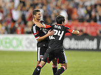 D.C. United midfielder Lewis Neal (24) celebrates his score with teammate Perry Kitchen. D.C. United defeated The New England Revolution 2-1 at RFK Stadium, Saturday September 15, 2012.