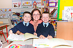Holymount National School junior infants first day at school. Pictured Eoin Collins, Alan O'Leary and their teacher Linda Dennehy.