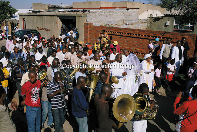 A brass band performs at a wedding in Diepkloof. The couple was welcomed back to the house after the church ceremony.