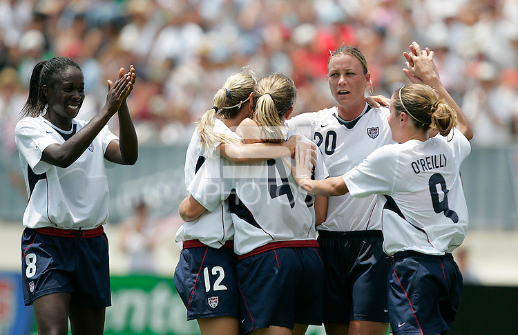USA's, left to right, Tina Frimpong, Leslie Osborne, Cat Whitehill, Abby Wambach, and Heather O'Reilly celebrate a Whitehill goal.during a 5-0 victory over Ireland in San Diego, California, Sunday, July 23, 2006.
