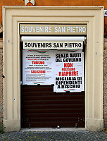 Shops selling souvenirs and sacred articles near the Basilica of Saint Peter remain closed<br /> Roma May 20th 2020. Covid-19 Italy further relaxes lockdown. After Italy further eased the restrictions two days ago, many shops in centre of Rome and near St Peter's basilica, remain closed due to  the lack of tourists and faithfuls. On many closed shutters were put up signs asking the Government an economic help.<br /> Photo Samantha Zucchi Insidefoto
