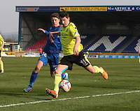 Kenny McLean crossing under pressure from Ryan Christie in the Inverness Caledonian Thistle v St Mirren Scottish Professional Football League Premiership match played at the Tulloch Caledonian Stadium, Inverness on 29.3.14.