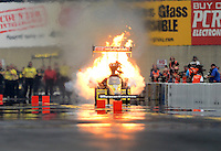 Oct. 6, 2012; Mohnton, PA, USA: NHRA top fuel dragster driver Spencer Massey explodes an engine on fire during qualifying for the Auto Plus Nationals at Maple Grove Raceway. Mandatory Credit: Mark J. Rebilas-