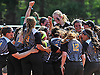Adelphi softball teammates celebrate after their 4-1 win over Southern New Hampshire University in Game 2 of the NCAA Division II East Super Regional at Adelphi University on Thursday, May 12, 2016. Adelphi swept the best-of-three series to advance to D2 College World Series.