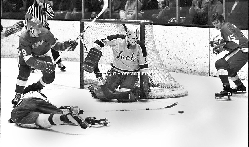 Seals vs RedWings 1971: goalie Gary Smith, Wings #15 Rene LeClerc, and #19 Hank Monteith..(photo/Ron Riesterer)