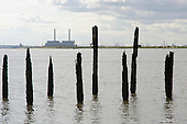 Disused dock on the Kent shore of the Thames estuary opposite Tilbury Power Station.  The station burns coal, cofires oil and biomass, and is operated by RWE NPower.