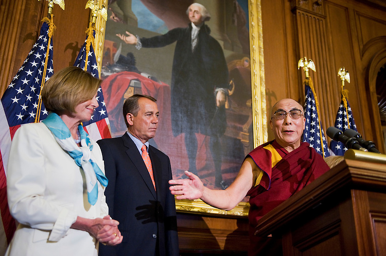 """UNITED STATES - JULY 07:  The Dalai Lama of Tibet, Tenzin Gyatso, speaks at a news conference in the Capitol's Rayburn Room, after a meeting with Speaker John Boehner, R-Ohio, center, House Minority Leader Nancy Pelosi, D-Calif., left, and other members of Congress.  Boehner remarked they discussed the Dalai Lama's shared values with the United States including """"freedom, tolerance and respect for human dignity."""" (Photo By Tom Williams/Roll Call)"""