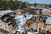 Firefighting foams covers the scene of a crash of an F/A-18D Hornet assigned to Strike Fighter Squadron (VFA) 106, in Virginia Beach, Virginia on April 6, 2012. Initial reports indicate that at approximately 12:05 p.m., the jet crashed just after takeoff at an apartment complex in Virginia Beach. Both air crew safely ejected from the aircraft and are being treated at a local hospital. .Mandatory Credit: Antonio P. Turretto Ramos / US Navy via CNP
