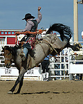 Britt Jessop earns a score of 72 points on a Southwick Rodeo Company bronc during saddle bronc competition at the Southeast Weld County CPRA Rodeo in Keenesburg, Colorado on August 12, 2006.