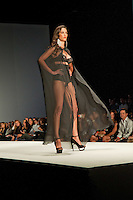 A standing-room-only crush for the opening night's 'Lingerie and Swimwear Showcase' during the 13th Annual Miami Beach International Fashion Week, the largest Latin American and international fashion event in the world, held at the Miami Beach Convention Center, Miami Beach, Florida, USA, March 3, 2011.  Photo by Debi Pittman Wilkey