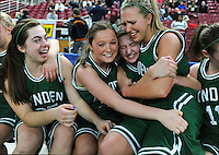 With their victory against Archbishop Murphy secure, the Lynden girls basketball team begins to celebrate from the bench before being named the 2A Washington State champions at the Yakima SunDome on Saturday, March 14, 2009. Lynden won, 48-41.