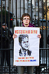 "© Joel Goodman - 07973 332324 . 09/12/2010 . London , UK . A man with a placard with a caricature of Nick Clegg and the words "" Nick Clegg Shame on you shame on you for turning blue "" standing at the gates of Downing Street . Students and their supporters demonstrate in Parliament Square in London against government cuts to student support , Educational Maintenance Allowance ( EMA ) and rising university tuition fees . Photo credit : Joel Goodman"