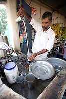 January 26th 2008 _Trivandrum, India _A street merchant mixes of cup of hot Indian tea in Trivandrum, India.  Trivandrum is located in the southern state of Kerala.  Photograph by Daniel J. Groshong/Tayo Photo Group