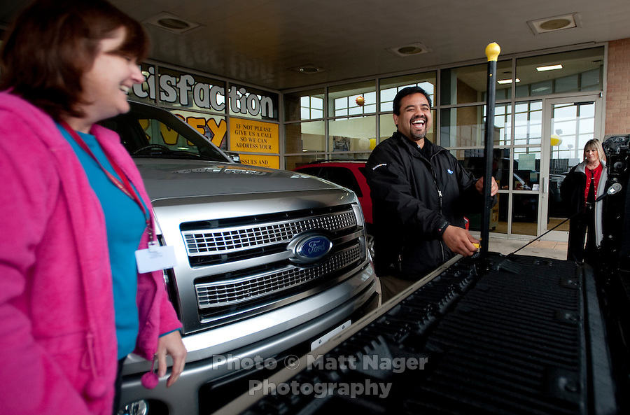 Michelle Bailey (cq, left) laughs with Sales Consultant Eli Martinez (cq) after a test drive at Bankston Ford in Frisco, Texas, Thursday, Jan., 28, 2009. Ford reported gains in earnings for the first time in four years...PHOTOS/ Matt Nager