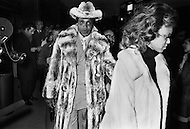 Manhattan, New York City, NY - March 8, 1971<br /> Notorious Harlem drug kingpin Frank Lucas attends Ali vs. Frazier boxing match with his wife, wearing a $100,000 floor-length chinchilla coat and a matching $25,000 hat. That and the fact that he had wrangled better seats than even Frank Sinatra certainly caught the attention of the police they investigated.<br /> Lucas was an organized crime boss and heroin dealer who operated in Harlem during the late 1960s and early 1970s. He has questionably boasted of buying his heroin in Southeast Asia&rsquo;s &lsquo;Golden Triangle&rsquo; and smuggling the drug in the coffins of dead American servicemen from Vietnam War. His story was turned into the Hollywood movie, &lsquo;American Gangster&rsquo;. It is only after the release of the movie that I realized I had Frank Lucas on my contact sheets, so those photos are published for the first time.